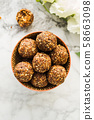 Energy balls with healthy ingredients on marble 58663098