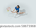 Young woman in blue shirt playing tennis. Youth, flexibility, power and energy. 58673968
