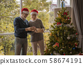 Elderly couples are helping to decorate the 58674191