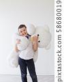 Boy with big toy polar bear white 58680019