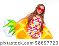 happy child on summer vacation, girl in a swimsuit with a wide smile on her face 58697723