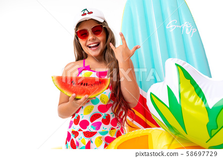 closeup smiling girl on a white background, the child holds in his hands a watermelon surrounded by 58697729