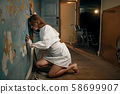 Female patient in strait jacket, insanity 58699907