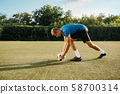 Male soccer player prepares to hits the ball 58700314