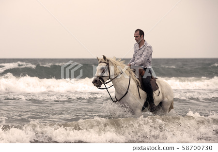 riding man and horse 58700730