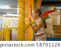 Adorable little girl playing in kids labyrinth 58701126