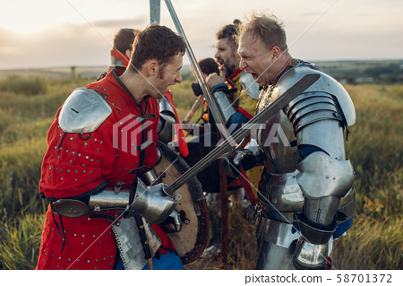 Medieval knights fight with sword and axe 58701372