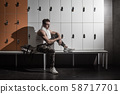 Modern athlete resting on bench 58717701