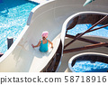 Little girl at the water slide on sun holidays 58718916