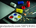 Art materials and poster color bottle on black cement floor. Concept of art education. 58719161