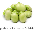 Heap of fresh green broad beans isolated 58721402