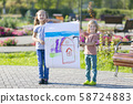 Children proudly show their pictures. 58724883