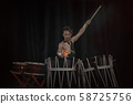 Taiko drummer drum drums on stage on a black 58725756
