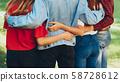 true friendship men women standing hugging park 58728612