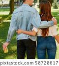 romantic date couple embracing nature park 58728617
