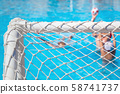 Children paly water polo in swimming pool 58741737
