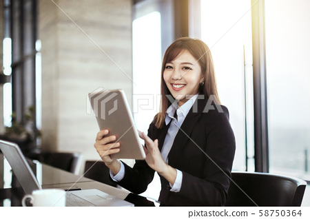 young business woman working in office 58750364