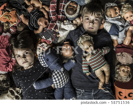 Creepy children with scary dolls 58751536