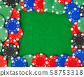 Frame made of casino chips on green table 58753318