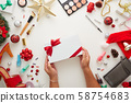Christmas decorations woman hand holding gift box 58754683