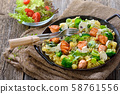 Italian pasta with fried cuts of salmon fillet, horseradish and a sauce of cream 58761556