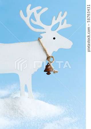 White Wooden Reindeer on a light blue background 58763431