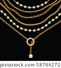 Background with pears and chains golden metallic necklace. On black 58764272
