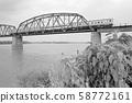 A diesel train that crosses the Ishikari River Bridge on the Sennuma Line 58772161
