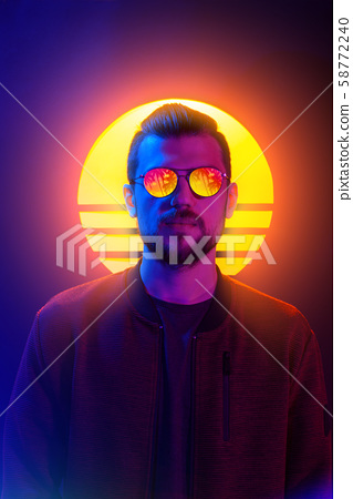 80s sci-fi futuristic fashion poster style violet neon. Retro wave synth vapor wave portrait of a young man in sunglasses. 58772240