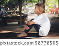 Asian kid lonely boy sitting in feel solitary sad 58778505