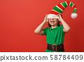 Santa's elf on bright color background 58784409