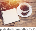 hot coffee cup with coffee bean and notebook on wooden table. coffee background menu for cafe or coffee shop 58792535