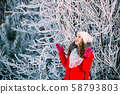 Young Beautiful Pretty Caucasian Girl Woman Dressed In Red Jacket And White Hat Smiling In Snowy 58793803