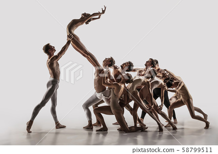 The group of modern ballet dancers. Contemporary art ballet. Young flexible athletic men and women. 58799511