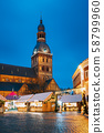 Riga, Latvia. Christmas Market On Dome Square With Riga Dome Cathedral. Christmas Tree And Trading 58799960
