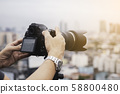 Professional photographer taking photo of city  58800480