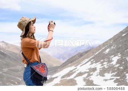 Young woman enjoy her camera in journey 58800488