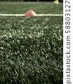 Soccer training equipment. Green artificial turf 58803127