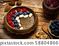 Chia seed healthy porridge with berry fruits 58804866