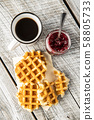 Tasty sweet waffles with raspberry jam and tea 58805733