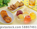 A collection of fruit jelly and baked confectionery 58807461