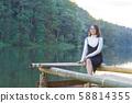 Asian woman sitting on raft. 58814355