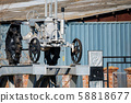 View of old grey tractor exposed outdoors 58818677