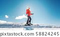 Woman enjoying her winter vacation on ski 58824245