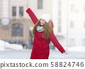 Happy redhead girl enjoying sunny winter day 58824746