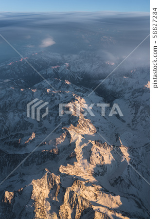Clouds and sunset plane window view in Caucasus 58827284