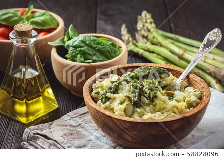 Asparagus and spinach risotto , italian cuisine. 58828096