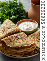 Savory pancakes (crepes) with parsley. 58829230