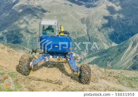 excavator works in the alps 58831958