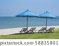 Couple of beach chair and blue umbrella 58835801